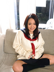 Hot teen Rui Natsukawa poses on the floor