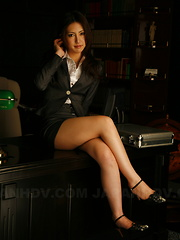 Dark haired Julia Nanase strips at her work