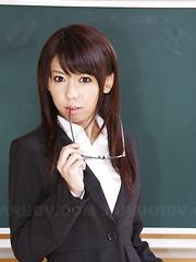 Teacher Maho Sawai shows her slit in class