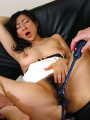 Brunette maid Emiko Koike pleases two dicks