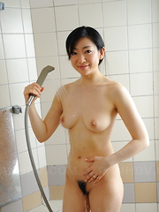Pale and arousing Emiko Koike shows her body