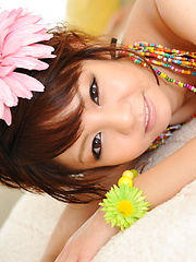Hot dark haired Japanese babe shows her body