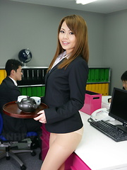 Sexy Japanese lady showing off in her office