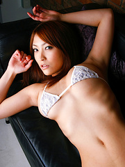 Rika Hoshimi Asian with big jugs shows pussy with thong stuck in