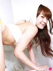 Rika Kawamura Asian shows ass and love box in yellow shorts