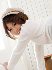 Risa Aika Asian with sexy smile has naughty behind in short skirt