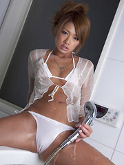Rumika Asian doll with such hot ass enjoys shower over clothes