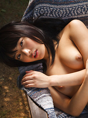 Kana Yume Asian shows nude playful tits and hairy cunt in nature
