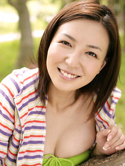 Meguru Ishii Asian shows big tits in green bra in the forest